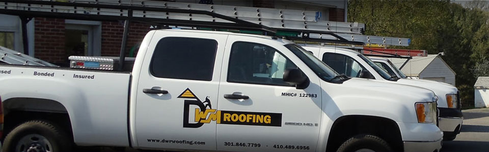 DWM Roofing trucks
